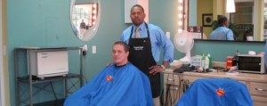 Barber and his Superman Hair Cutting Capes